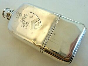 1770-1 LONDON STERLING POCKET FLASK, SLIP CUP BASE, SHIELD ARMS & TWO CRESTS