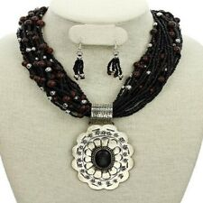 gorgeous black seed bead strand necklace with huge ornate concho & earrings