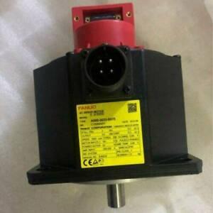 one FANUC motor A06B-0033-B075 used tested