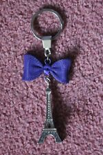 Mini Paris Eiffel Tower Keyring .  Silver and purple.. New condition.