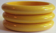 VINTAGE TRIO OF HIGH DOMED CREAMED CORN YELLOW BAKELITE OVAL BANGLE BRACELETS