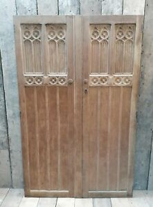 A PAIR OF RECLAIMED GOTHIC HAND CARVED OAK DOORS IDEAL CUPBOARD / PANTRY DP0314