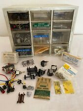 Toy train parts: switches, wheels, speakers, hardware (screws, nuts, washers)