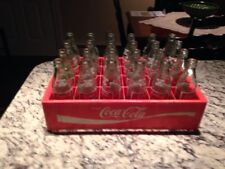 (24) Coca Cola Green Bottles with Red Plastic Carrying Case