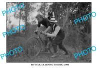 8x6 OLD PHOTO OF CYCLIST LEARNING TO RIDE c1900 AUST