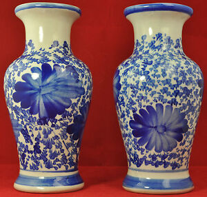Oriental pair of blue & white hand painted vases
