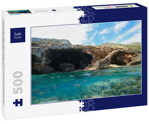 Lais Puzzle - Felsküste mit großer Höhle an der Küste und Fischen unter Wasse...