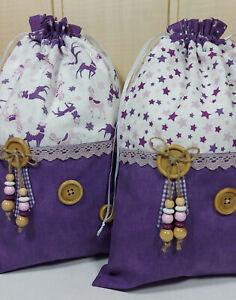 Traumhafte Weihnachtssäckchen in lila mit Knöpfen