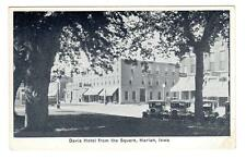 IA - HARLAN IOWA Postcard DAVIS HOTEL FROM THE SQUARE CAFES DRUG STORE OLD CARS