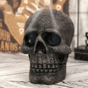 A PAIR OF SPOOKY SKULL INCENSE CONE HOLDERS