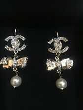 CHANEL CRYSTAL CC DROP CRYSTAL BOW WITH PEARL EARRINGS STAMPED 16S