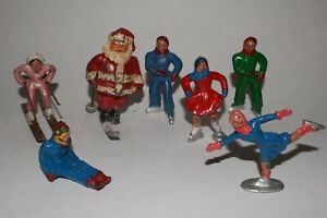LOT OF 7 BARCLAY VINTAGE LEAD FIGURES SKATERS AND SKIING SANTA LOT #24