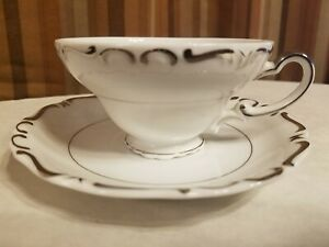 Ucagco China Heirloom White with Silver Trim Teacup & Saucer