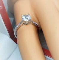 Sterling silver solitaire ring with sidestones.Hallmarked 925 size O (#1}