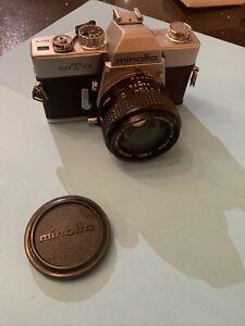 Minolta SRT101 with 55mm F1.7 Rokkor. Leather case.