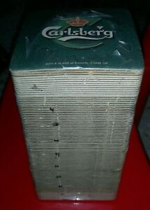 A STACK OF CARLSBERG COASTER