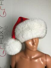 Santa hat: Blue Fox Fur trim. Red velvet top with pompon.