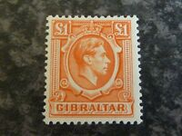 GIBRALTAR POSTAGE STAMP SG131 £1 ORANGE UN MOUNTED MINT