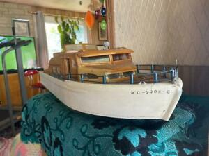 Vintage hand made wooden cabin cruiser boat