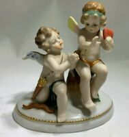 Antique Sevres Style Pair of Cupid In Love Porcelain Figurines