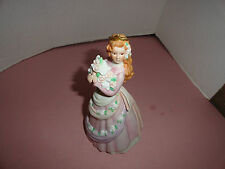VINTAGE ENESCO - GIRL w/ FLOWERS FIGURE    BY KAREN HAHN ABOUT 8 1/2 INCHES TALL