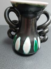 Spiral handles vase with pink interior and almost fat lava exterior glazing,