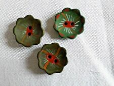 Three vintage flower shaped painted buttons
