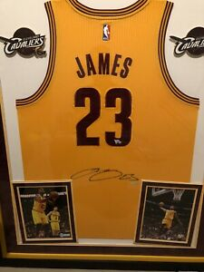 Beautiful upper deck signed and authenticated Lebron James Adidas home jersey