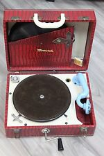 Vintage Monarch portable gramophone with red faux leather gator case