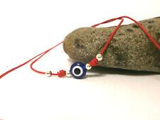 "Pulsera minimalista  ""Amuleto"" ojo turco con hilo rojo (julio)"