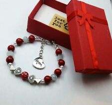 """Red """"MOM""""- Coral beads , chain/ beaded bracelet with silver charm."""