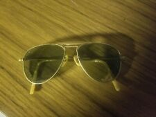 vintage sunglasses, unmarked. bakelite trim gold colored frames