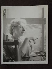 WOMAN WITH GLASSES SITTING IN A CHAIR SMOKING A CIGARETTE Vtg 1960's PHOTO