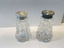 Antique American ABP Cut Glass Salt and Pepper Shakers with Ornate Silver Caps