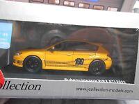 SUBARU Impreza WRX Sti 2009 orange Pastrana Edition 199 IXO J Collection 1:43
