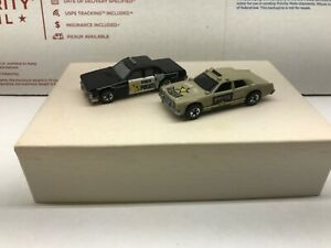 Hot Wheels 80's Star Taxi Police and State Police Crack Up Lot of 2 HK/Malaysia