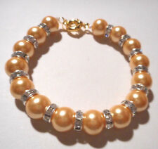 Handmade cream colored pearl shell bracelet with rondelle bead seperators