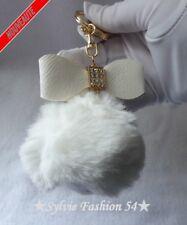 Bijou de sac porte clé anneau mousqueton noeud strass pompon fourrure blanc