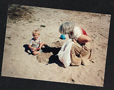 Vintage Photograph Woman Sitting By Baby Playing in Sand At the Beach