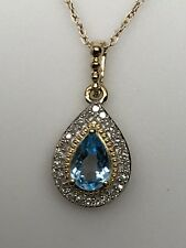 10K Yellow Gold Pear Shape Blue Topaz and 0.08ct twt Diamond Pendant December