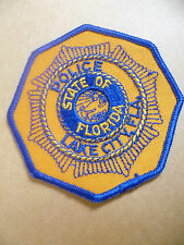 Patches: STATE OF FLORIDA LAKE CITY USA POLICE PATCH (NEW* apx. 9.5x9.5 cm)