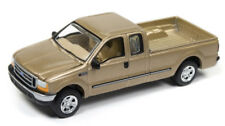 1/64 JOHNNY LIGHTNING 2004 Ford F-250 in Gold Metallic w/ tow hitch