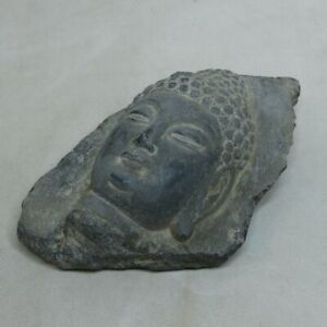 E933: Buddhist head image of stone carving such as Gandhara or Tibet, etc