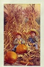 When The Frost Is On The Pumpkin two boys with corn stalks and pumpkins