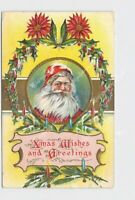 ANTIQUE POSTCARD CHRISTMAS XMAS WISHES AND GREETINGS SANTA HOLLY POINSETTIA CAND
