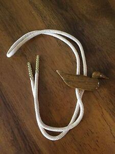 Shape of Duck Bolo Tie Cream Cord Gold Tone Tips