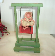 VINTAGE WOODEN TOY DOLL SWING, CELLULOID DOLL