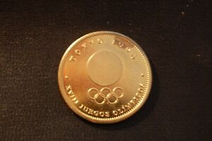 1964 ONE GOLD COLOURED TOKYO OLYMPIC TOKEN