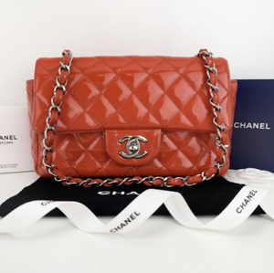CHANEL Quilted Patent Leather New Mini Classic Flap in Red