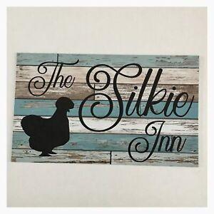 The Silkie Inn Blue Sign
